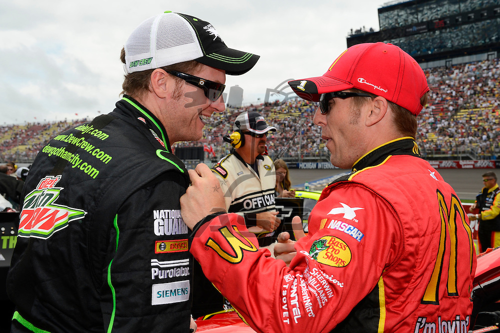 Brooklyn, MI - JUN 17, 2012: Jamie McMurray (1) and Dale Earnhardt, Jr. (88) during race action for the Quicken Loans 400 race at the Michigan International Speedway in Brooklyn, MI.