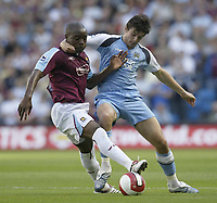 Photo: Aidan Ellis.<br /> Manchester City v West Ham United. The Barclays Premiership. 23/09/2006.<br /> City's Joey Barton (R) gets to grips with West Ham's Nigel Reo Coker