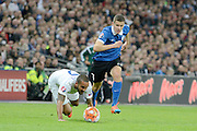 England striker Theo Walcott fouled by Artur Pikk during the Group E UEFA European 2016 Qualifier match between England and Estonia at Wembley Stadium, London, England on 9 October 2015. Photo by Alan Franklin.