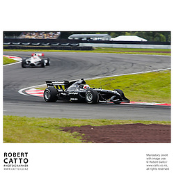 Jonny Reid leads James Hinchcliffe at the A1 Grand Prix of New Zealand at the Taupo Motorsport Park, Taupo, New Zealand.