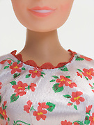 close up of torso of female doll
