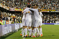 Real Madrid´s Gareth Bale celebrates a goal with Xabi Alonso, Di Maria, Benzema, Pepe and Sergio Ramos during the Spanish Copa del Rey `King´s Cup´ final soccer match between Real Madrid and F.C. Barcelona at Mestalla stadium, in Valencia, Spain. April 16, 2014. (ALTERPHOTOS/Victor Blanco)