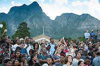 CAPE TOWN, SOUTH AFRICA - Thursday 9 April 2015, part of the crowd during the removal of the statue of CECIL JOHN RHODES at the University of Cape Town. Rhodes (5 July 1853 &ndash; 26 March 1902) was a British businessman, mining magnate, and politician in South Africa. An ardent believer in British colonialism, Rhodes was the founder of the southern African territory of Rhodesia, which was named after him in 1895. South Africa's Rhodes University is also named after Rhodes. He set up the provisions of the Rhodes Scholarship, which is funded by his estate. <br /> Photo by Roger Sedres/ ImageSA