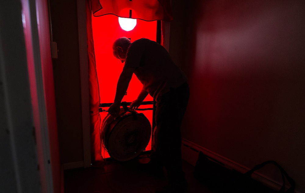 Mike Lehman from the Coporation for Appalachian Development (COAD) prepares for a blower test at 47 West Washington Street during an energy audit on Tuesday, June 23, 2015. The test allows auditors to see how air tight a home is.  Photo by Ohio University  /  Rob Hardin
