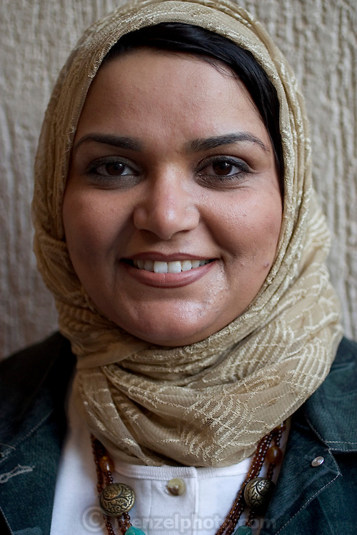 (MODEL RELEASED IMAGE) Wafaa Abdul Aziz Al Qadini works as a government-employed school inspector. (Supporting image from the project Hungry Planet: What the World Eats.)