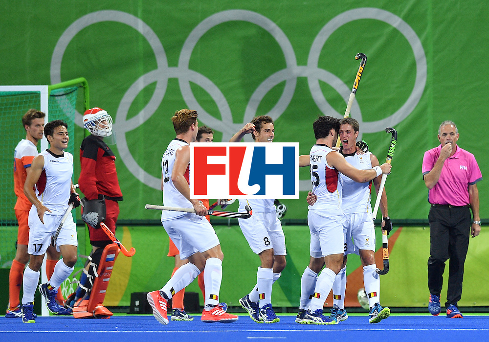 Belgium's Jerome Truyens (R) celebrates a goal with teammates during the men's semifinal field hockey Belgium vs Netherlands match of the Rio 2016 Olympics Games at the Olympic Hockey Centre in Rio de Janeiro on August 16, 2016.  / AFP / Carl DE SOUZA        (Photo credit should read CARL DE SOUZA/AFP/Getty Images)