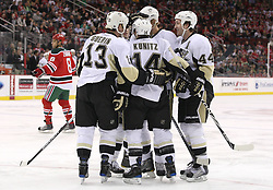 Mar 17, 2010; Newark, NJ, USA; The Pittsburgh Penguins celebrate a goal by Pittsburgh Penguins center Jordan Staal (11) during the first period at the Prudential Center.
