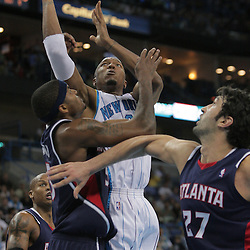 05 November 2008:  New Orleans Hornets forward David West (30) shoots between Atlanta Hawks defenders Josh Smith (5) and Zaza Pachulia (27)during a 87-79 victory by the Atlanta Hawks over the New Orleans Hornets at the New Orleans Arena in New Orleans, LA..