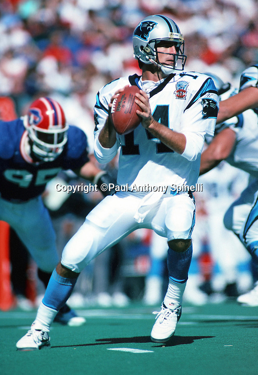 Carolina Panthers quarterback Frank Reich (14) drops back to pass during the NFL football game against the Buffalo Bills on Sept. 10, 1995 in Orchard Park, N.Y. The Bills won the game 31-9. (©Paul Anthony Spinelli)