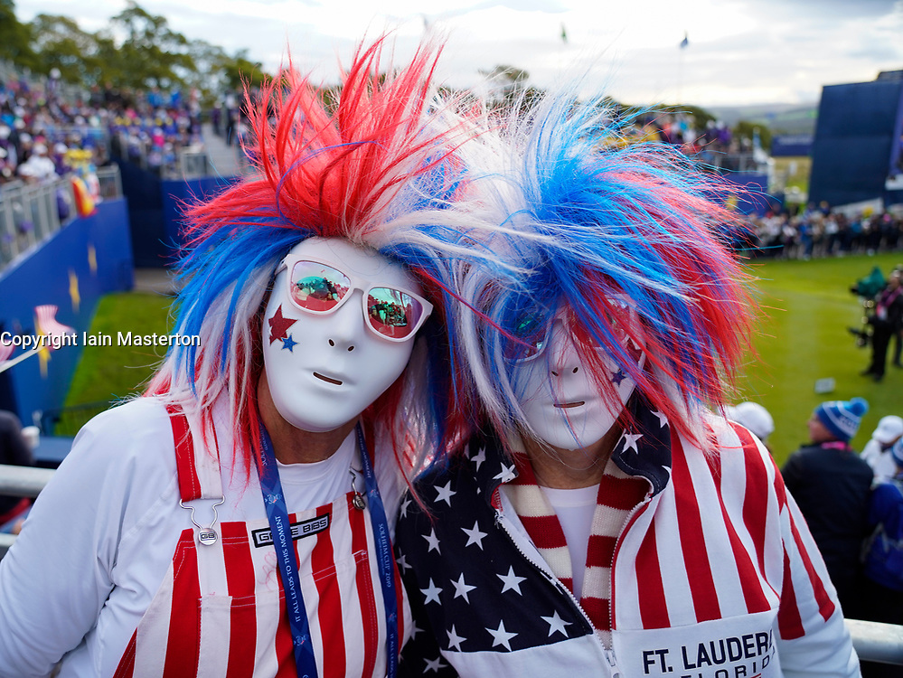 Auchterarder, Scotland, UK. 14 September 2019. Saturday morning Foresomes matches  at 2019 Solheim Cup on Centenary Course at Gleneagles. Pictured; Team USA fans in patriotic fancy dress at the 1st tee. Iain Masterton/Alamy Live News