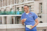 Portrait of an African American male surgeon having a sandwich