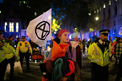 © Licensed to London News Pictures. 09/10/2019. London, UK. Extinction Rebellion protesters march in Parliament Square. Police continue to attempt to clear roads in Westminster on the third day of the protest.  Photo credit: George Cracknell Wright/LNP