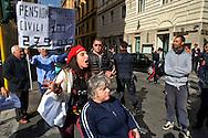 Roma 4 Novembre  2014.<br /> Manifestazione davanti al ministero dell'Economia del Comitato 16 Novembre, associazione di persone malate di Sla e loro famigliari, per chiedere il ripristino del fondo della non autosufficienza  ridotto a 250 milioni con la legge di Stabilit&agrave;, non solo torni a 350 milioni ma venga aumentato a un miliardo.<br /> Rome November 4, 2014. <br /> Demonstration in front of the Ministry of Economy Committee November 16, an association of people sick  with ALS and their families, to ask for the restoration fund of self-sufficiency reduced to 250 million by the law of stability, not only back to 350 million but is increased one billion.