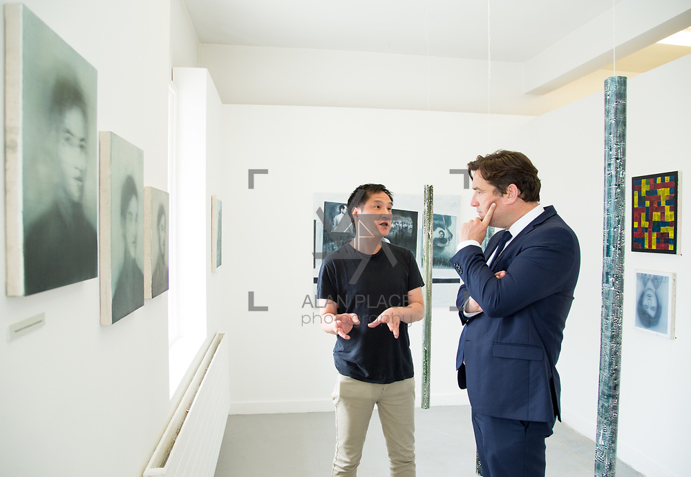 11.06.2017         <br /> International award winning artists are among the almost 200 graduates of Limerick School of Art and Design who's work went on exhibition at the LSAD Graduate Show 2017.<br /> <br /> Pictured is 4th year graduating Painting  student, Gary Kin-San Chan discussing his work titled 'The Binary Oppositions and The Myth of Sisyphus' with John Concannon, Director of Creative Ireland who officially opened the show.<br />  <br /> Students from the college took control of the over-riding message of this historical show as they conceptualised, designed and delivered on the theme - be.cause.<br />  <br /> The hypothesis conceived by Graphic Design graduates Cassandra Walsh and David Reilly, is derived from the fact the graduates have now reached a stage where they are confident with their work, their interpretations and creative solutions. As creative minds they have an innate need to &ldquo;do&rdquo; something. There is just this need to create, be.cause.<br /> . Picture: Alan Place.