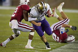 September 26, 2009; Stanford, CA, USA;  Washington Huskies quarterback Jake Locker (10) is forced out of bounds by Stanford Cardinal cornerback Corey Gatewood (2) in the fourth quarter at Stanford Stadium. Stanford won 34-14.
