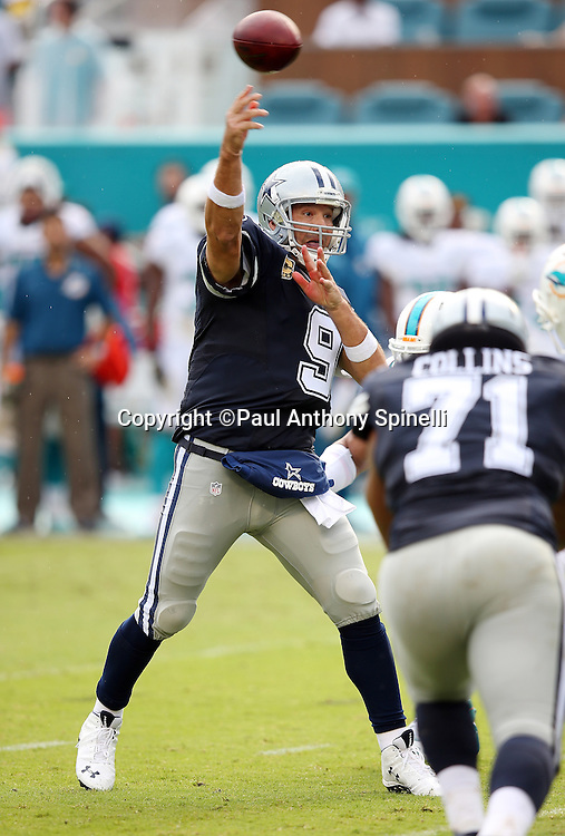Dallas Cowboys quarterback Tony Romo (9) throws a pass during the 2015 week 11 regular season NFL football game against the Miami Dolphins on Sunday, Nov. 22, 2015 in Miami Gardens, Fla. The Cowboys won the game 24-14. (©Paul Anthony Spinelli)