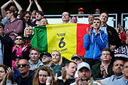 MK Dons fans with a Cisse flag during the EFL Sky Bet League 2 match between Milton Keynes Dons and Exeter City at stadium:mk, Milton Keynes, England on 25 August 2018.