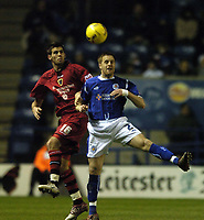 Photo: Jonathan Butler.<br />Leicester City v Cardiff City. Coca Cola Championship. 23/12/2006.<br />Joe Ledley of Cardiff jumps with Alan Maybury of Leicester.