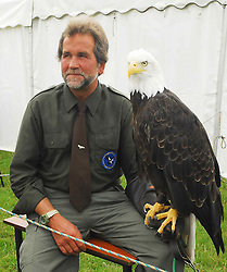 Lothar Muschketat with his bald eagle from the Irish Raptor research centre in Ballymote was a big attraction at the Tourmakeady Show .