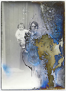 mother posing with toddler on a severely eroding glass plate