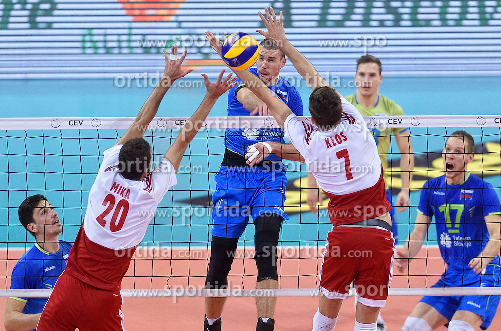 Alen Pajenk #2, Mateusz Mika #20, Karol Klos #7 during volleyball match between National teams of Poland and Slovenia in Quarterfinals of 2015 CEV Volleyball European Championship - Men, on October 14, 2015 in Arena Armeec, Sofia, Bulgaria. Photo by Ronald Hoogendoorn / Sportida