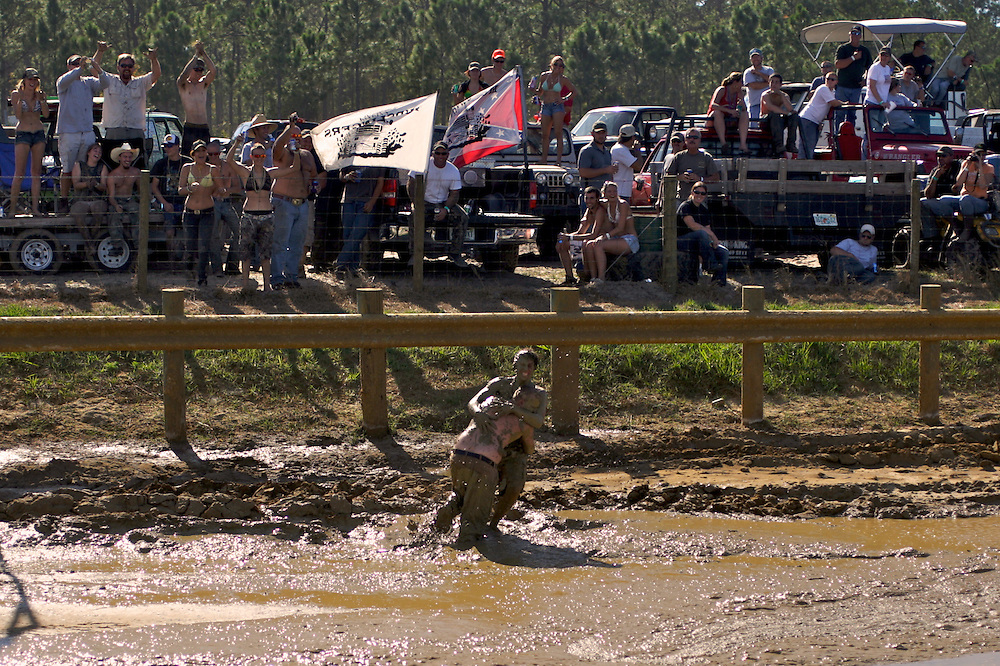 Revelers wrestle on the mud track at the Redneck Yacht Club in Punta Gorda, Fla. Photo by: Greg Kahn