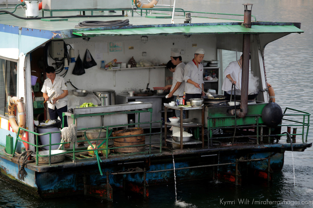 Asia, China, Guilin. Cooks prepare lunch for cruise passengers on Li River.