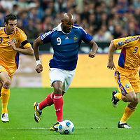 05 September 2009: French forward Nicolas Anelka dribbles the ball passing by Romanian defenders Maximilian Nicu and Razvan Rat during the World Cup 2010 qualifying football match France vs. Romania (1-1), on September 5, 2009 at the Stade de France stadium in Saint-Denis, near Paris, France.