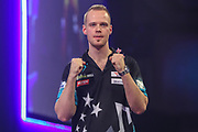 Max Hopp wins his second round match against Benito van de Pas during the PDC William Hill World Darts Championship at Alexandra Palace, London, United Kingdom on 20 December 2019.