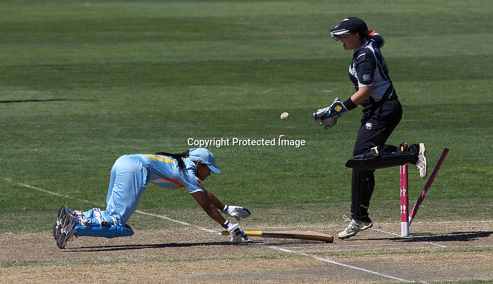 Sydney-March 17:  Amita Sharma is run out from a throw by Sophie Devine as keeper Rachel Priest celebrates during the match between New Zealand and India in the Super 6 stage of the ICC Women's World Cup Cricket tournament at North Sydney  Oval, Sydney, Australia on March 17, 2009. Photo by Tim Clayton.