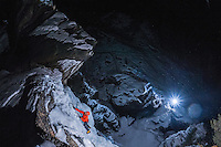 A top-view perspective on Jeff Mercier, professional alpine climber, during a rapid night ascent of Cascatte di Lillaz icefall.