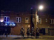 Police officers in the street in East Flastbush near a memorial for Kimani Gray at E 55 St and Church Ave in Brooklyn, NY on Sunday, March 17, 2013...Photograph by Andrew Hinderaker