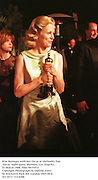 Kim Basinger with her Oscar Tony  at theVanity Fair Oscar  night party, Mortons, Los Angeles. 23 March 1988. Film 98155f31<br />