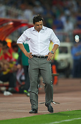 NOVI SAD, SERBIA - Tuesday, September 11, 2012: Wales' manager Chris Coleman looks dejected as his side lose 2-1 to Serbia during the 2014 FIFA World Cup Brazil Qualifying Group A match at the Karadorde Stadium. (Pic by David Rawcliffe/Propaganda)