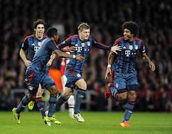 Bayern Munich's Toni Kroos celebrates his goal with team mates - Photo mandatory by-line: Joe Meredith/JMP - Tel: Mobile: 07966 386802 19/02/2014 - SPORT - FOOTBALL - London - Emirates Stadium - Arsenal v Bayern Munich - Champions League - Last 16 - First Leg