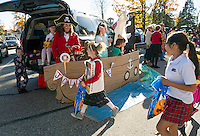Trunk or Treaters make a stop at the Jolly Roger pirate ship during Holy Trinity School's Halloween festivities on Monday afternoon.  (Karen Bobotas/for the Laconia Daily Sun)