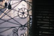 Two women walk along Ridola street, Matera, Italy, November 2000. &copy; Carlo Cerchioli<br /> <br /> Due donne camminano lungo via Ridola, Matera, Italia, novembre 2000.