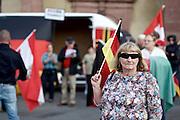 Frankfurt am Main | 21 Apr 2015<br /> <br /> Am Dienstag (21.04.2015) hielt die rassistische und islamfeindliche Gruppe PEGIDA (Patriotische Europ&auml;er gegen die Islamisierung des Abendlandes) an der Hauotwache neben der Katharinenkirche in Frankfurt am Main eine Mahnwache unter dem Motto &quot;Wir sind wieder da&quot; ab. Die Kundgebung war wie immer mit Hamburger Gittern abgesperrt und von starken Polizeikr&auml;ften bewacht. Etwa 1000 Menschen nahmen an den Gegenprotesten teil.<br /> Hier: Eine PEGIDA-Aktivistin tr&auml;gt eine als Sonnenbrille getarnte Videokamera-Brille, vermutlich das Modell &quot;Rollei Bullet Sunglasses Cam 100 Full HD 63&deg;&quot;.<br /> <br /> &copy;peter-juelich.com<br /> <br /> [Foto Honorarpflichtig | No Model Release | No Property Release]