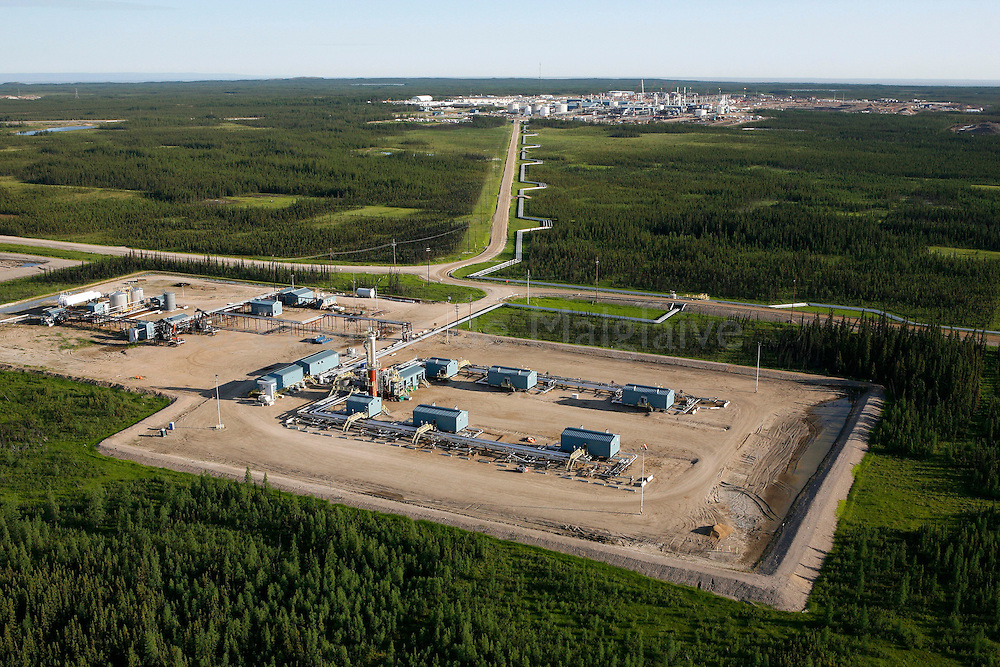 Suncor's Firebag  project  using Steam Assisted Gravity Drainage (SAGD) technology to extract oil. Deep tar sands are warmed with injected steam so the bitumen can be pumped. Production of steam by burning fossil energy causes the massive CO2 emission. This plant was built in the boreal forest near Fort Mc Murray. June 2008. © Etienne de Malglaive.