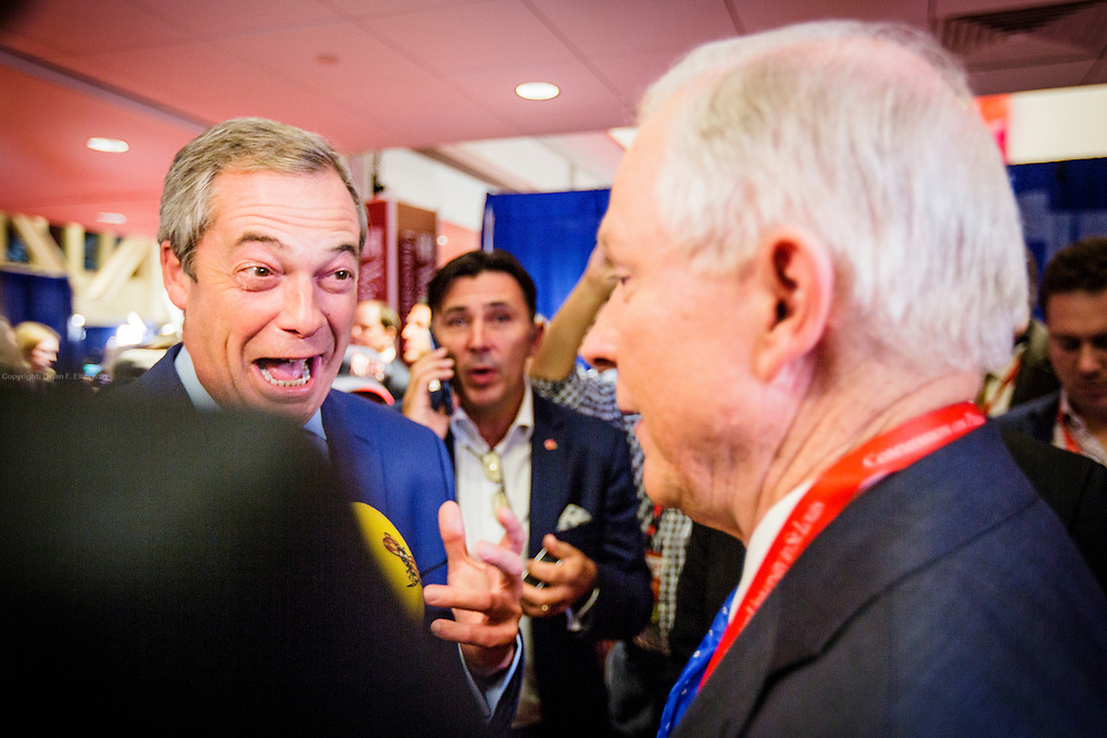 UKIP leader Nigel Farrage greets US Senator and Trump surrogate Jeff Sessions in the spin room after the Presidential Debate in St. Louis between Donald J. Trump and Hillary Clinton.