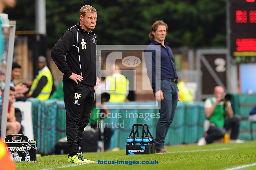 David Flitcroft of Bury (left) and Gareth Ainsworth of Wycombe Wanderers (right) watch on during the Sky Bet League 2 match at Adams Park, High Wycombe<br /> Picture by Seb Daly/Focus Images Ltd +447738 614630<br /> 06/09/2014