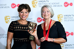 Kate Silverton (left) presents Kate Adie with her fellowship award in the press room at the Virgin TV British Academy Television Awards 2018 held at the Royal Festival Hall, Southbank Centre, London.