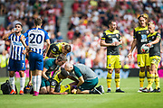 Yan Valery (Southampton) receiving treatment during the Premier League match between Brighton and Hove Albion and Southampton at the American Express Community Stadium, Brighton and Hove, England on 24 August 2019.