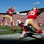 San Francisco 49ers cornerback Carlos Rogers (22) intercepts the ball in the end zone against Arizona Cardinals wide receiver Larry Fitzgerald (11) during an NFL regular season game on Sunday, Oct. 13, 2013 in San Francisco. The 49ers won the game, 32-20. (AP Photo/Ric Tapia)