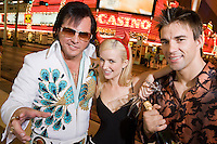 Couple and Elvis impersonator having fun