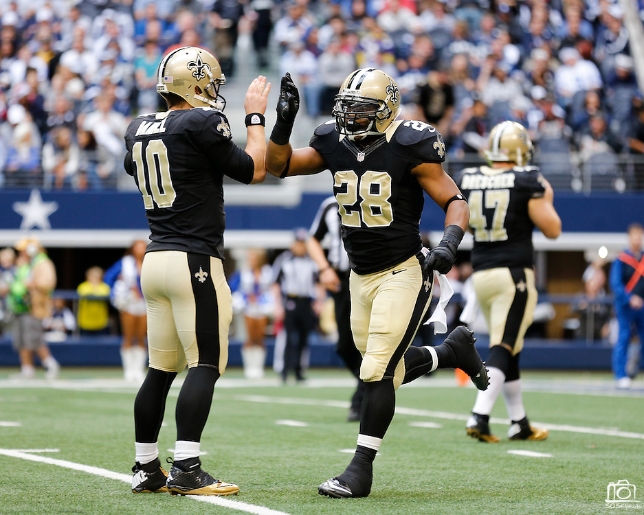 New Orleans Saints quarterback Chase Daniel (10) and running back Mark Ingram (28) high-five before kick off against the Dallas Cowboys at Cowboys Stadium in Arlington, Texas, on December 23, 2012.  (Stan Olszewski/The Dallas Morning News)