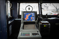 "VALLETTA, MALTA - 8 FEBRUARY 2017: A radar is seen here in the pilot house of the San Giorgio, an amphibious transport dock of the Italian Navy, in Valetta, Malta, on Febuary 8th 2017.<br /> <br /> As a consequence of the April 2015 Libya migrant shipwrecks, the EU launched a military operation known as European Union Naval Force Mediterranean (EUNAVFOR Med), also known as Operation Sophia, with the aim of neutralising established refugee smuggling routes in the Mediterranean. The aim of this new operation launched by Europe is to undertake systematic efforts to identify, capture and dispose of vessels as well as enabling assets used or suspected of being used by migrant smugglers or traffickers. On 20 June 2016, the Council of the European Union extended Operation Sophia's mandate reinforcing it by supporting the training of the Libyan coastguard.<br /> Thus far, following EUNAVFOR MED operation Sophia's activities, 101 suspected smugglers and traffickers have been apprehended and transferred to the Italian<br /> authorities and 380 boats were removed from the criminal organizations' availability. The Operation has saved 32.081 migrants, among whom 1888 children.<br /> <br /> On February 2nd 2017 Italian Premier Paolo Gentiloni and Prime Minister of the U.N. backed Libyan government Fayez al-Serraj signed a memorandum of understanding on cooperation to combat illegal migration, human trafficking and contraband and on reinforcing the border between Libya and Italy. The following day, as EU leaders meet in Malta for a summit, European Council President Donald Tusk said after talks with Serraj, that ""it is time to close the (migrant) route from Libya to Italy"" and that ""the EU has shown it is able to close the routes of irregular migration, as it has done in the eastern Mediterranean.""  Tusk said the Central Mediterranean route was ""not sustainable either for the EU or for Libya"", where he said traffickers were undermining the Libyan state's authority for their profit. Serraj's embat"
