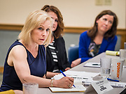 "24 MAY 2019 - WEST DES MOINES, IOWA: US Senator KIRSTEN GILLIBRAND (D-NY), left, chairs a community forum in the West Des Moines Public Library. Gillibrand unveiled her ""Family Bill of Rights"" during a forum in West Des Moines. The New York Senator has made family health and rights a centerpiece of her campaign. She is touring Iowa this week to support her candidacy to be the Democratic nominee for the US Presidency. Iowa traditionally hosts the the first selection event of the presidential election cycle. The Iowa Caucuses will be on Feb. 3, 2020.           PHOTO BY JACK KURTZ"