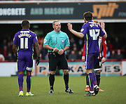 Chartlon Athletic defender, Marco Motta (47) protesting his innocence during the Sky Bet Championship match between Brentford and Charlton Athletic at Griffin Park, London, England on 5 March 2016. Photo by Matthew Redman.