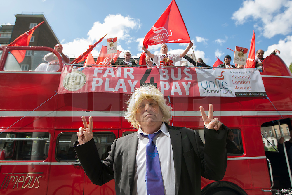 © licensed to London News Pictures. London, UK 16/05/2012. A Boris Johnson look-alike posing as off duty bus drivers protesting in an open-top bus as part of a Unite the Union campaign for an extra £500 Olympic payment for each bus driver, outside TfL HQ in central London, this morning (16/05/12). Photo credit: Tolga Akmen/LNP